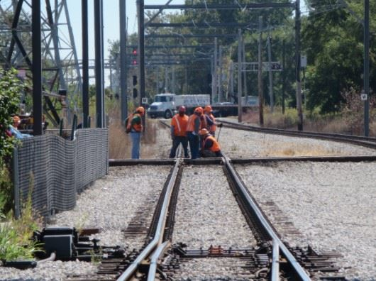 railroad workers on a train track